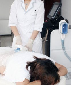woman having fat freezing treatment carried out on legs